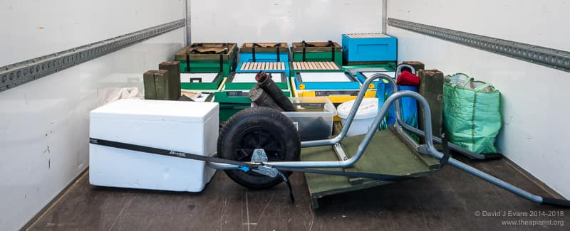 Hives, stands and wheelbarrow all strapped down tight